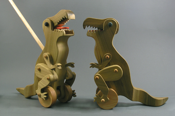 wooden articulated dinosaur push toy